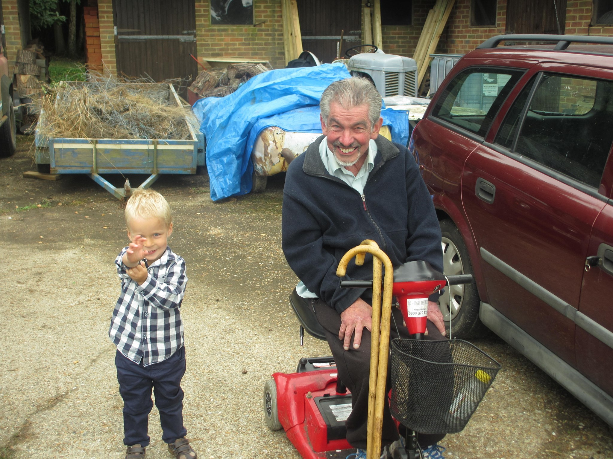 Dad with Luke down at the farm
