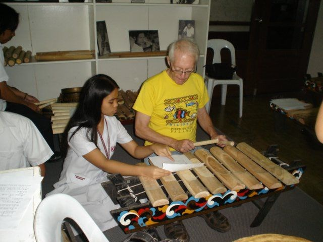 Rod trying to learn an indigenous musical instrument from the Philippines.