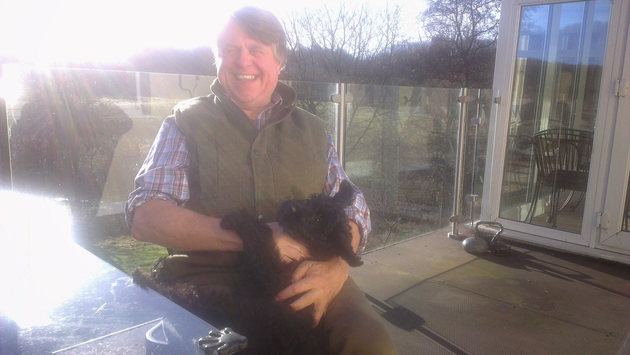 Jon loving his dog Esk in the sunshine at his lovely home