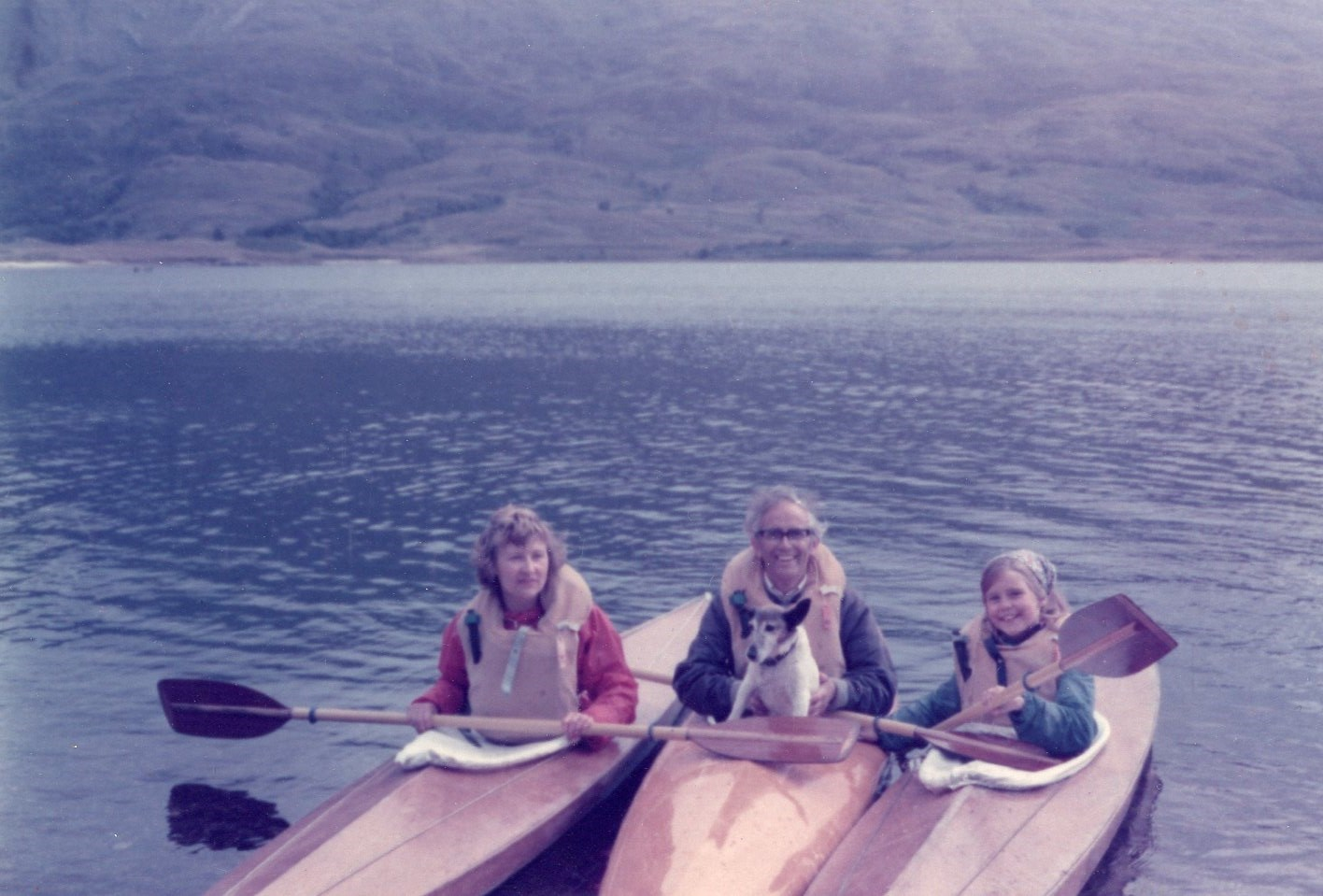 Dad loved canoeing - and making canoes! This is mum, dad, Jenny & our dog, Dixie out on the water.