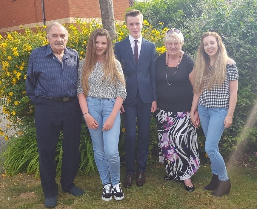 Grandma and grandad with their grandchildren  x