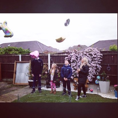Sending our baby brother a balloon to heaven????