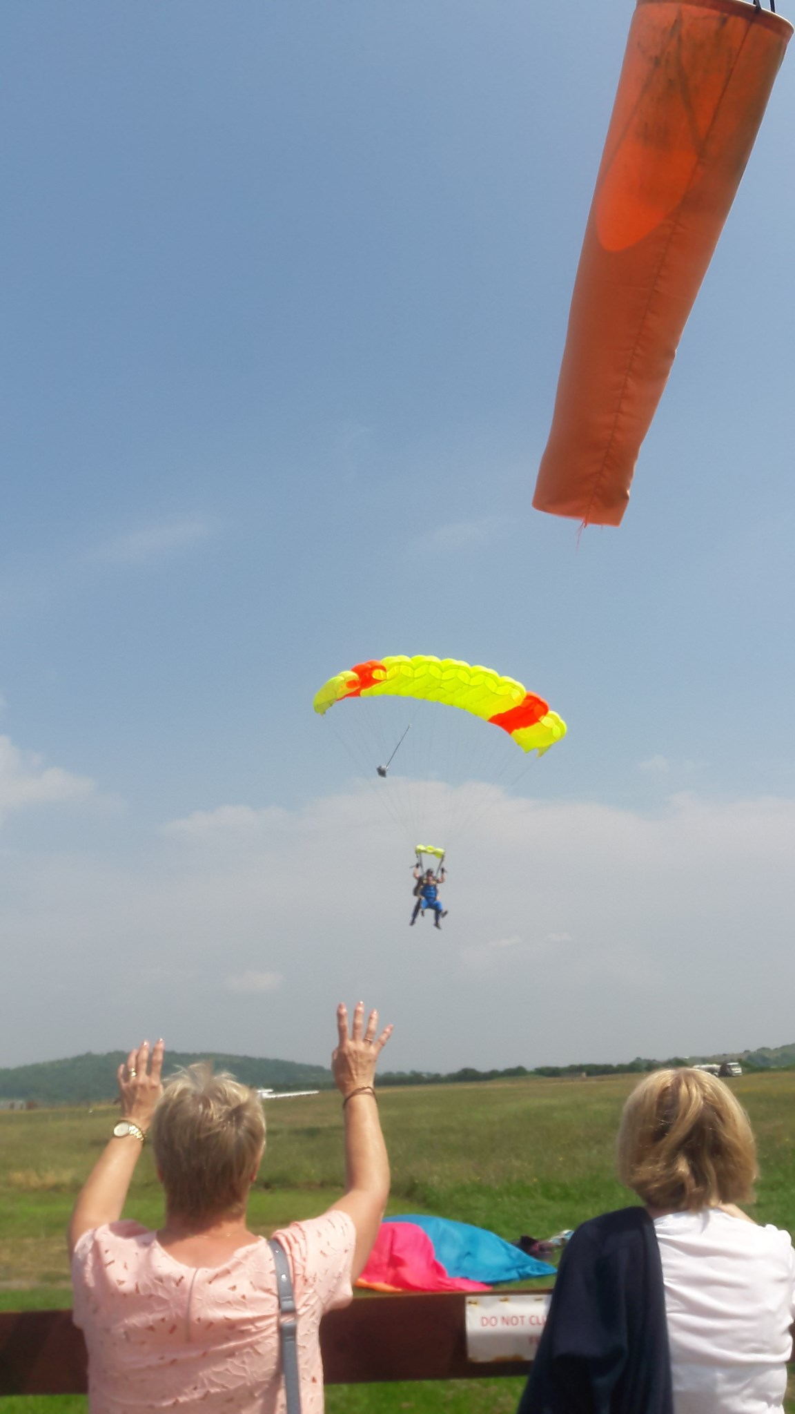 Caitlins friend Caitlin Tyson doing a sky dive and raised over £1000 for the air ambulance