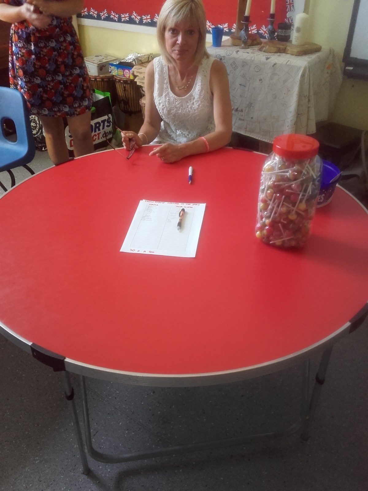 Sharron with the guess the sweets in a jar raising funds for brake
