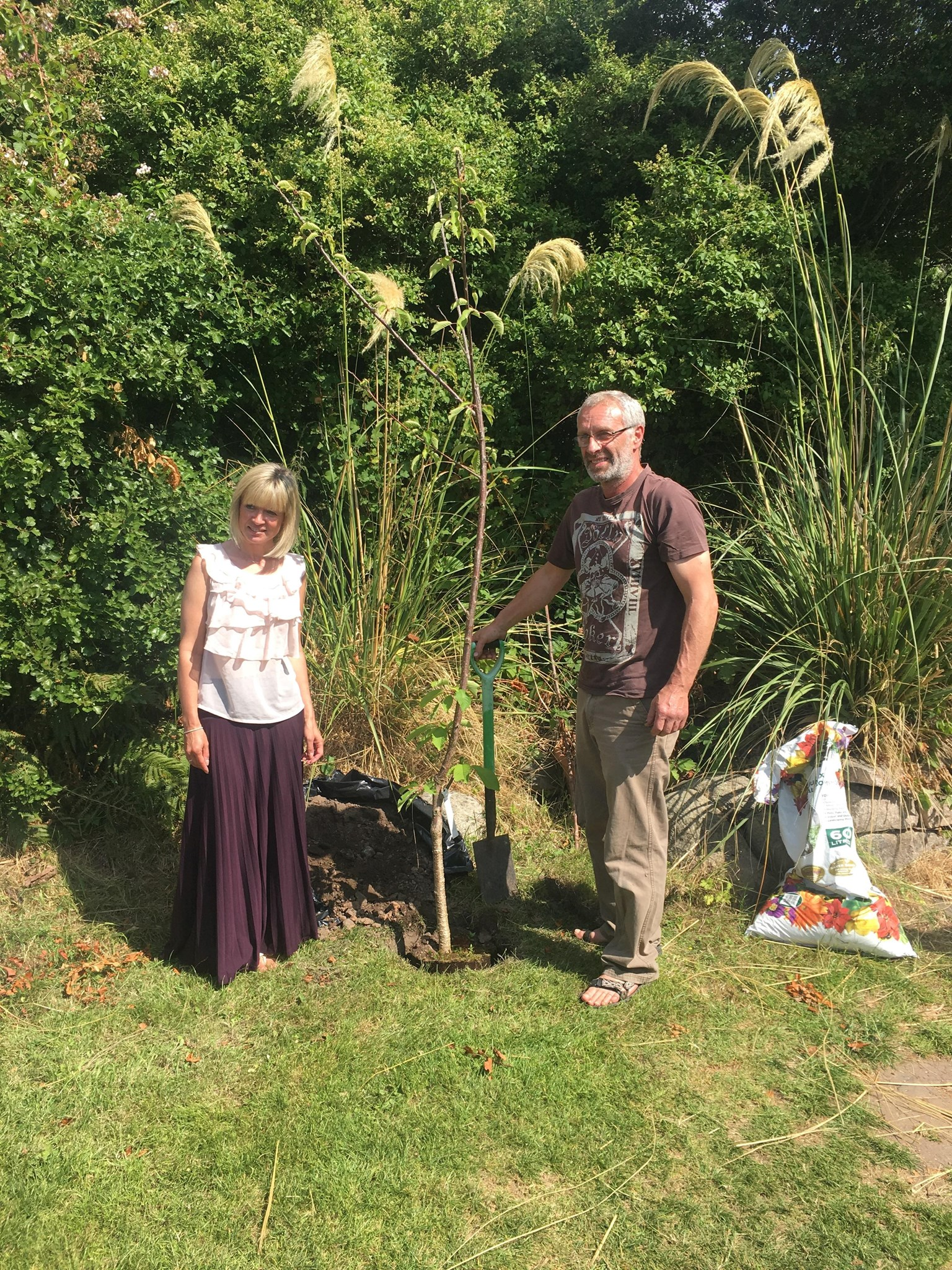 Mam & Dad planting the cherry tree